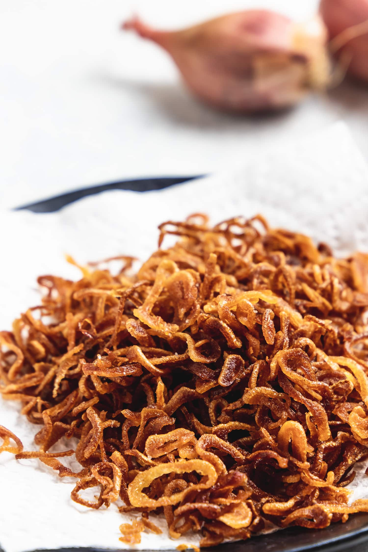crispy shallots draining on paper towels