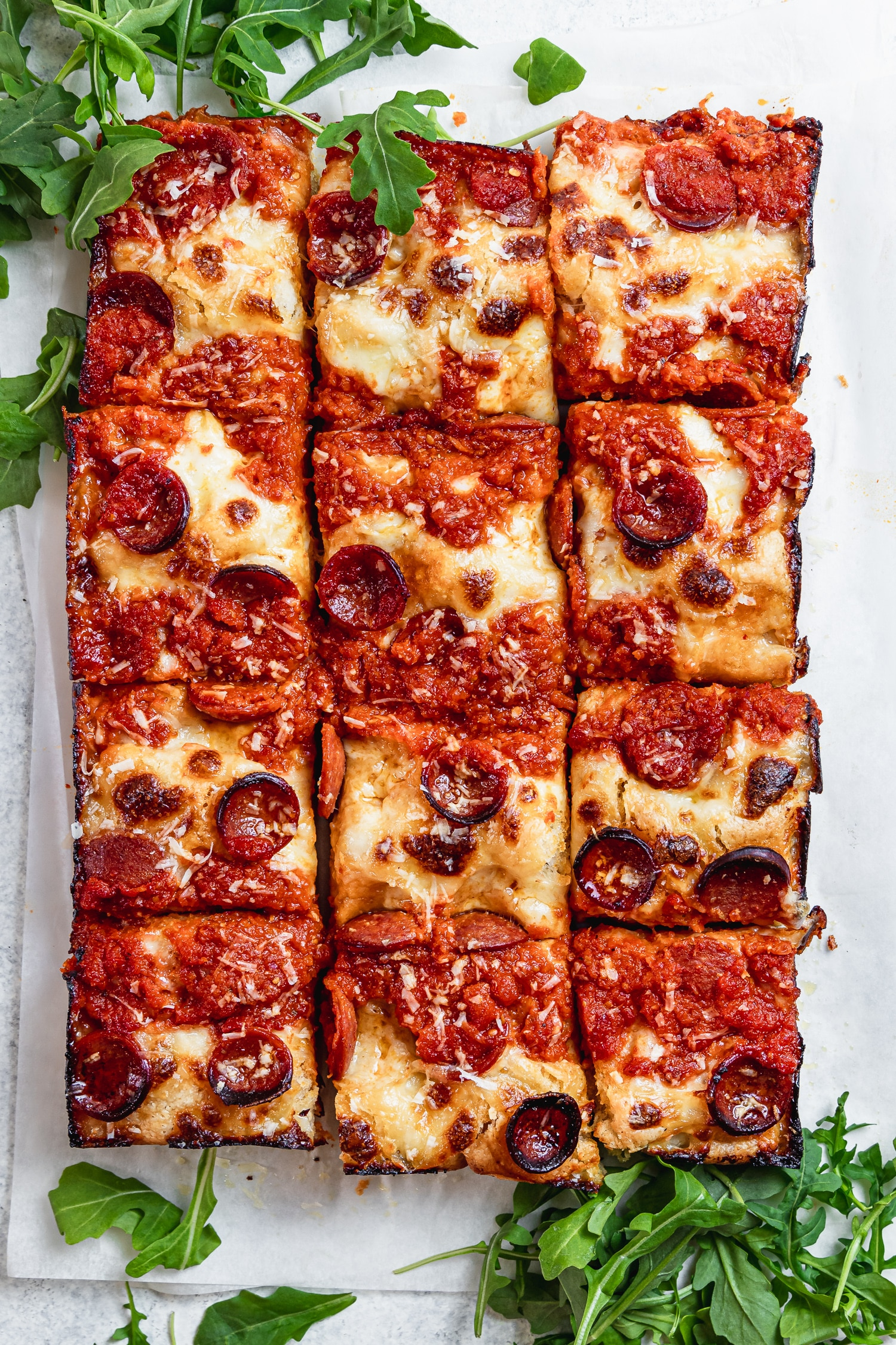 cooked detroit style pizza cut into slices