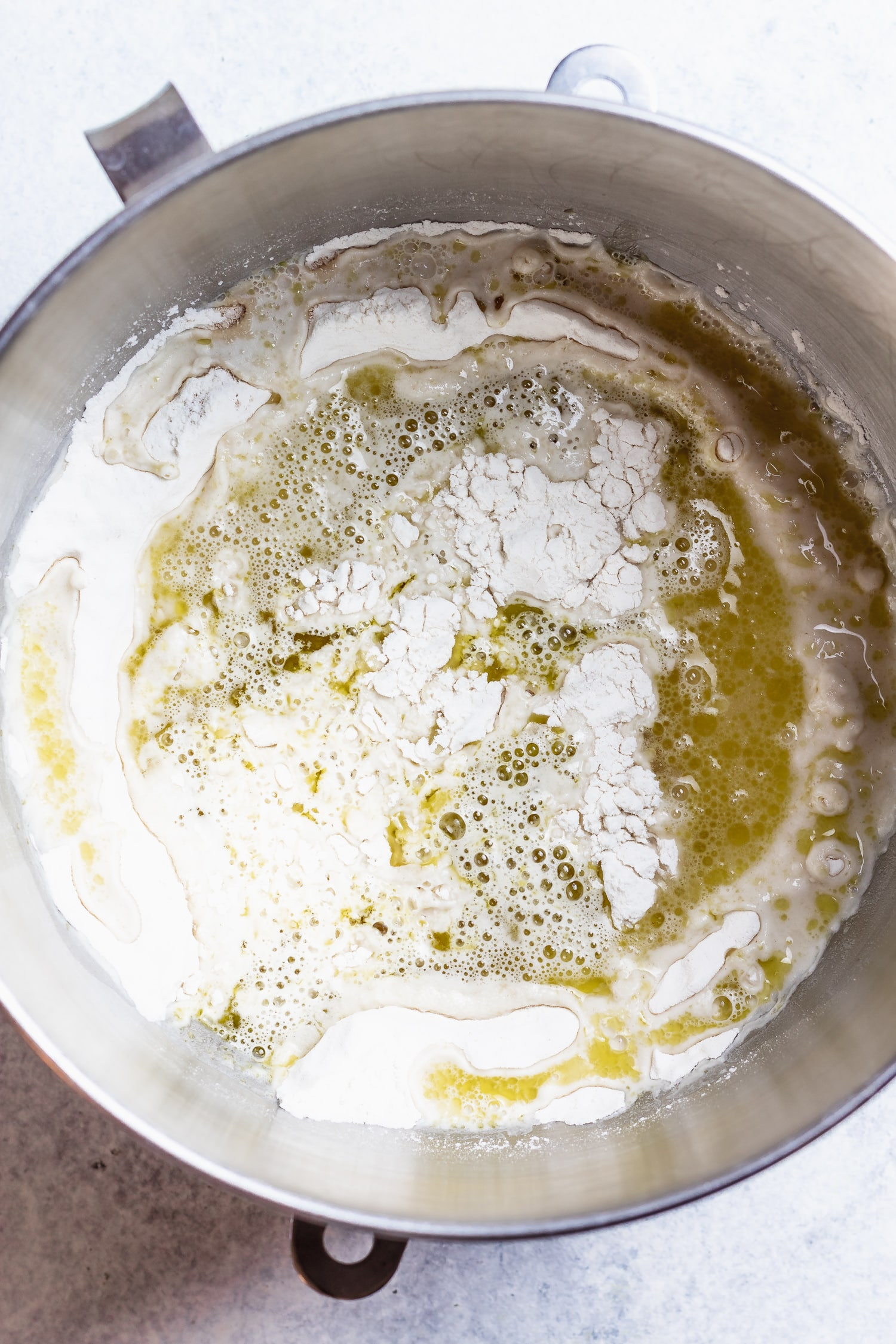flour, olive oil and water in a mixing bowl