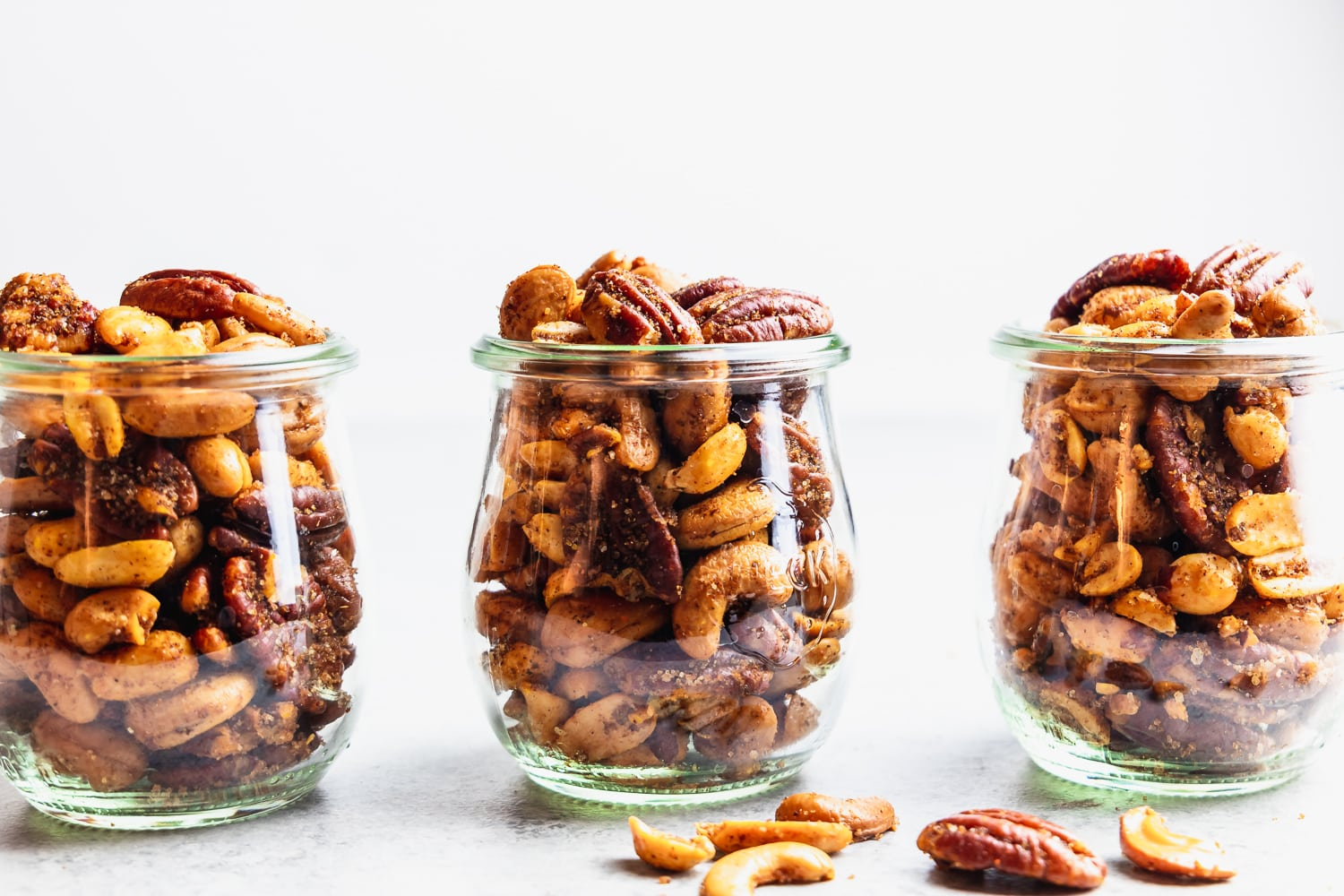 sweet and spicy mixed nuts in glass jars