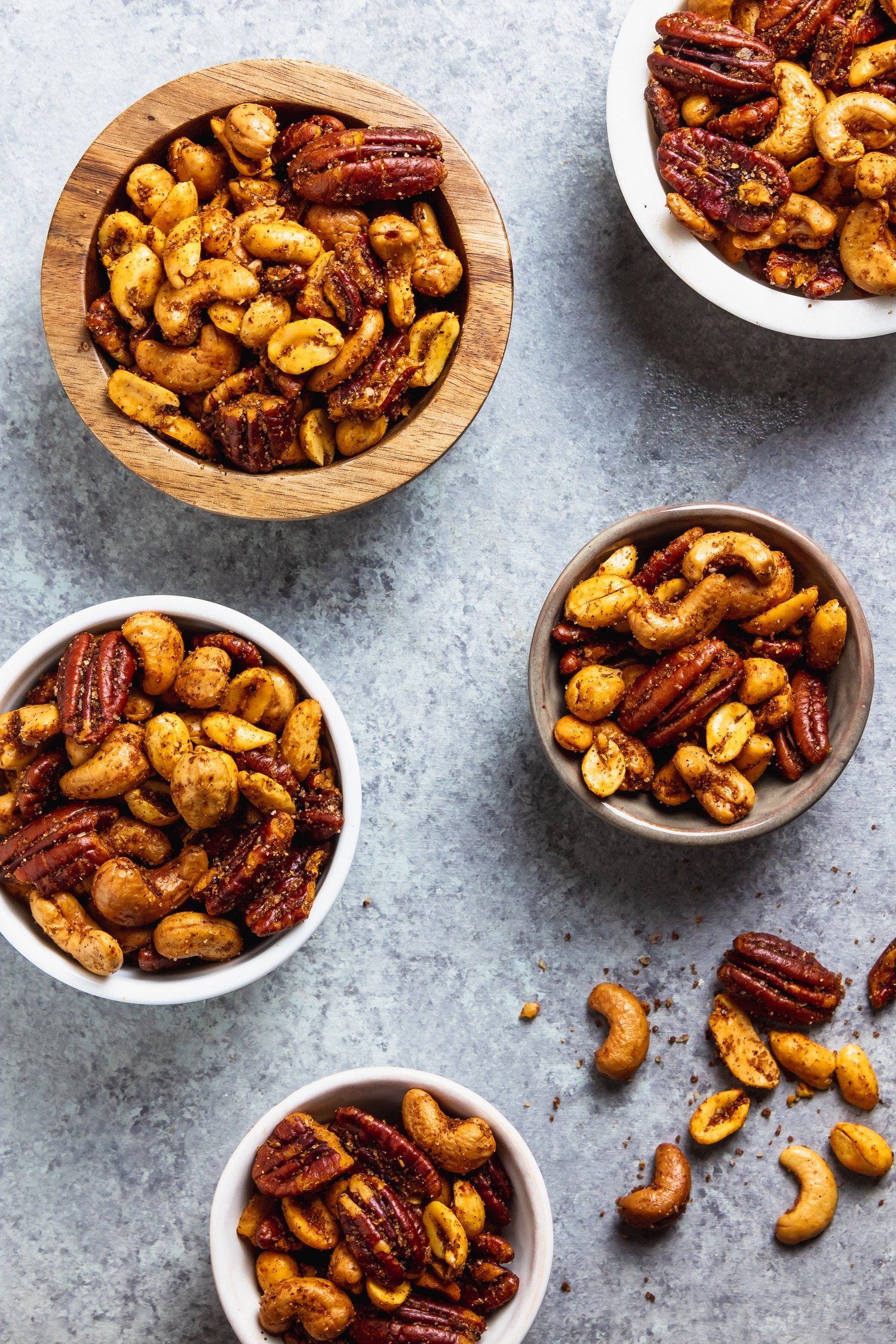 sweet and spicy mixed nuts in assorted bowls