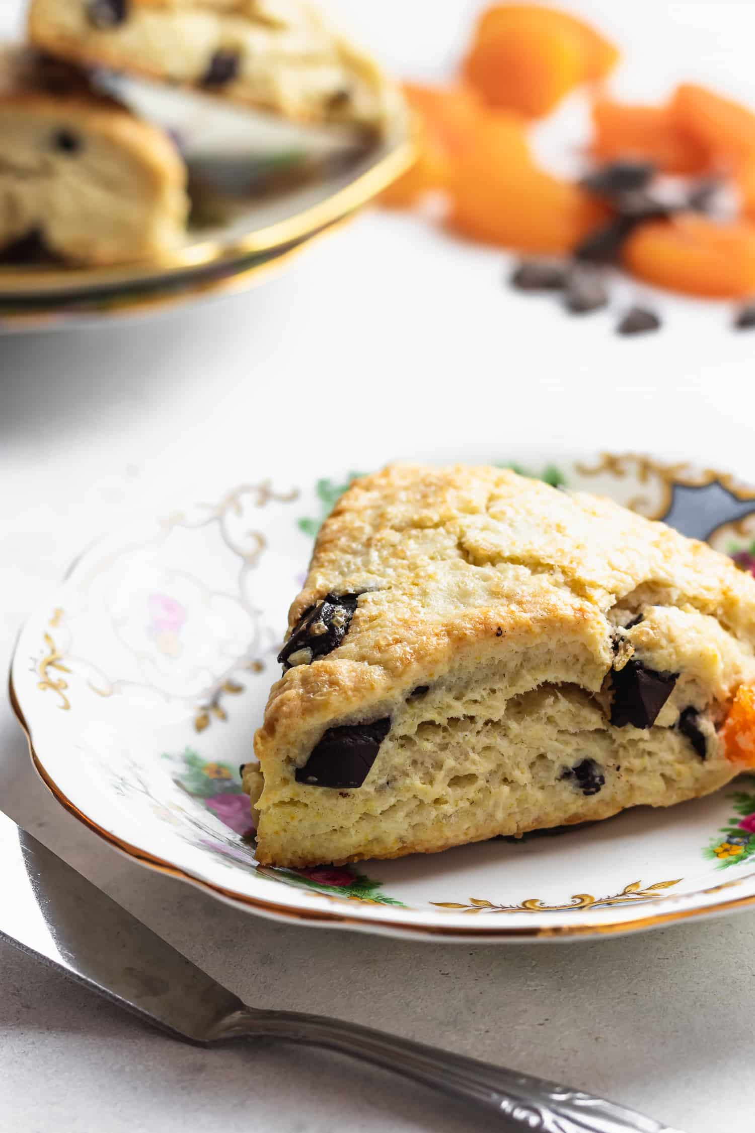 apricot chocolate chunk scone on elegant plate