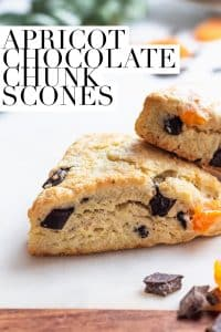 apricot chocolate chunk scones on a marble board with garnishes