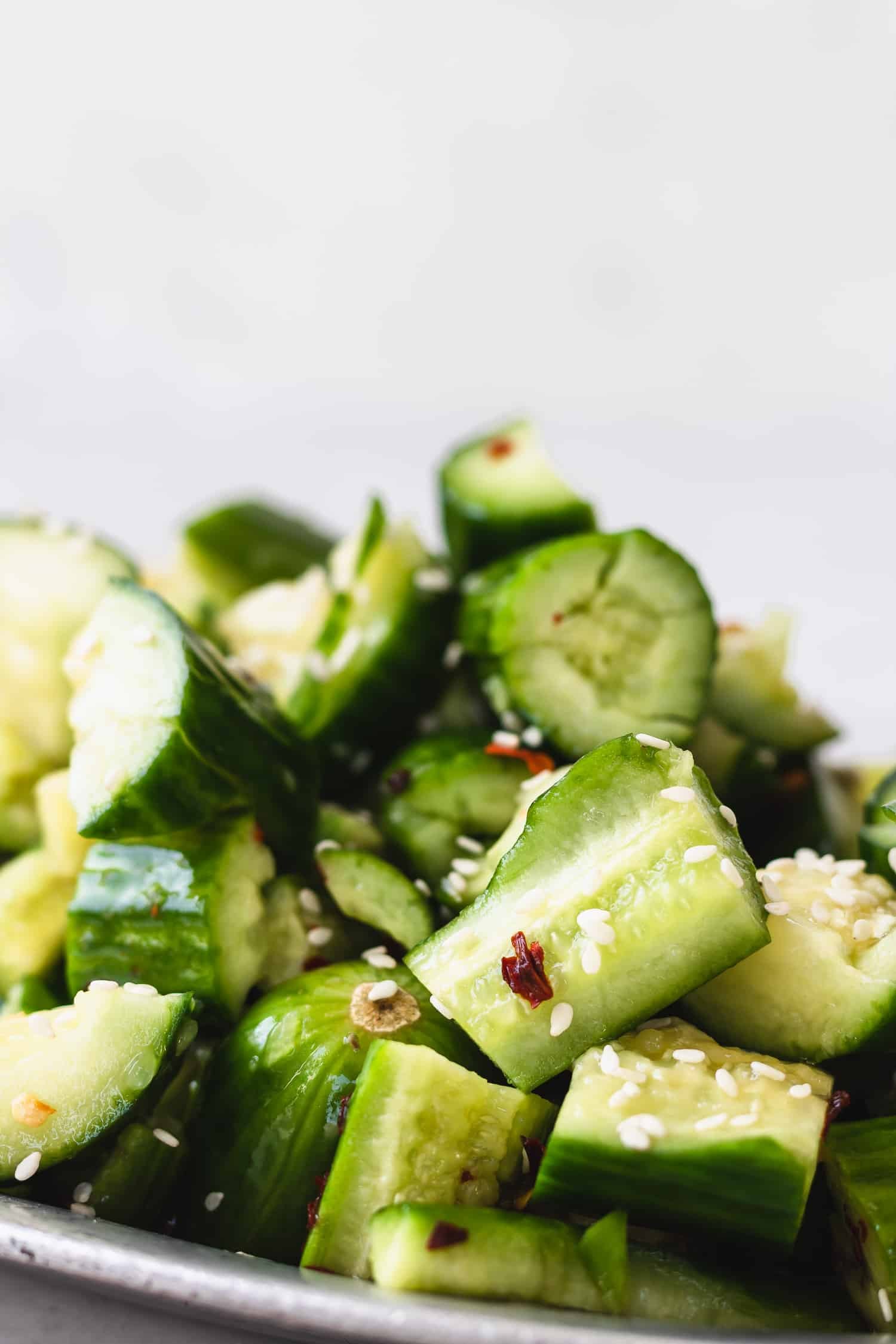 Smashed cucumbers dressed and garnished with sesame seeds