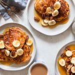 banana bread pancakes on plates with coffee
