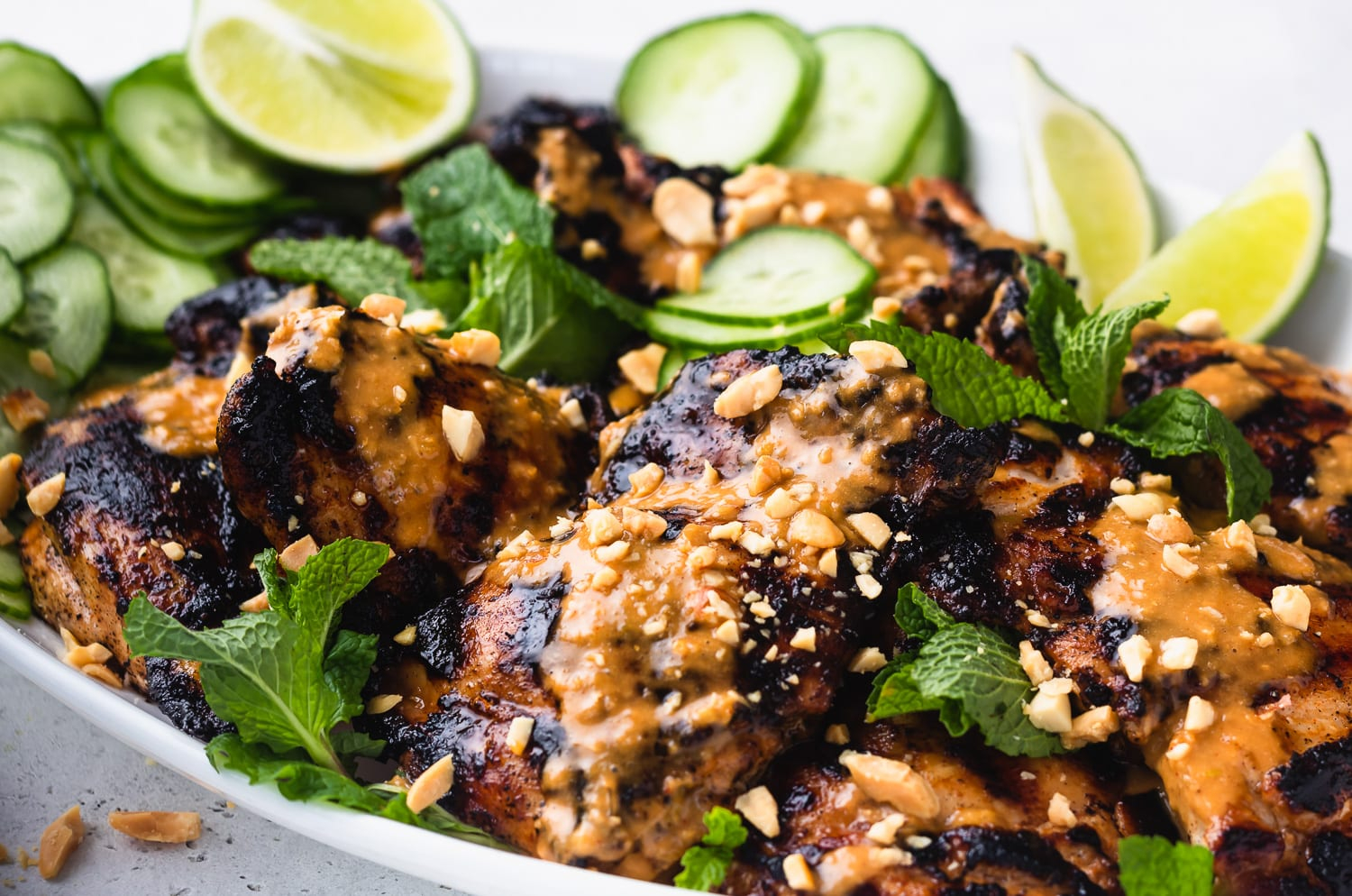 close up of finished grilled chicken with peanut sauce