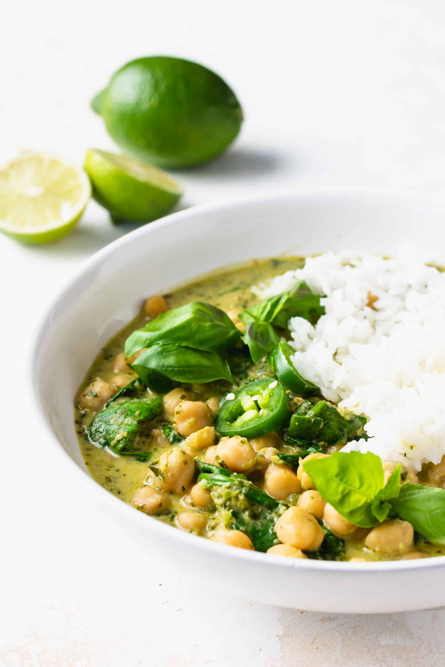 green curry chickpeas and rice in white bowl